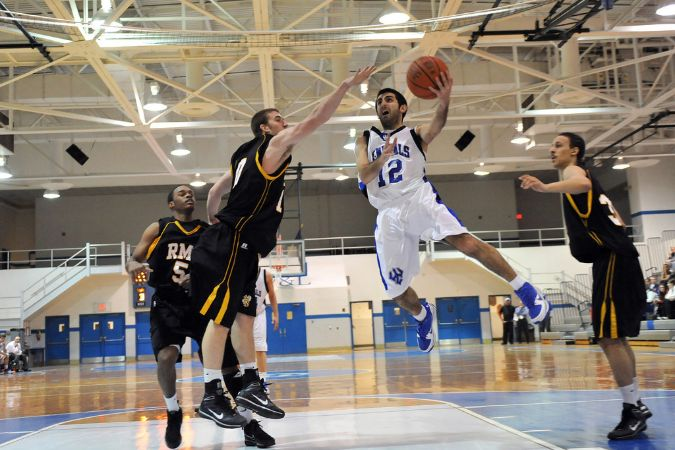 A W&L player makes a jump shot close to the net.