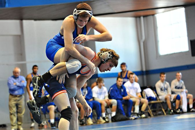 A W&L wrestler is on top of his standing opponent, trying to get him to the ground.