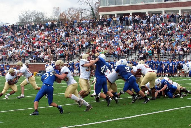 Full stands, the beginning of a football play.